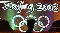 Pechino / Beijing 7/8/2008 Olimpiadi Pechino 2008 - Olympic Games .La silhouette di un poliziotto di fronte ai cinque cerchi olimpici a piazza Tiananmen ad un giorno dall'apertura ufficiale dei giochi.Foto Andrea Staccioli Insidefoto