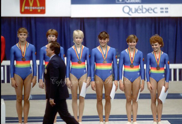 (L-R) Jana Furhmann, Jana Vogel, Ulrike Klotz, Martina Jentsch, Gabriele Fahnrich, Dagmar Kersten of  East Germany line-up during team medals ceremony at 1985 World Championships in women's artistic gymnastics at Montreal, Canada in mid-November, 1985.  Photo by Tom Theobald.