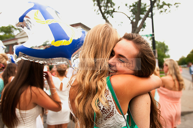 A Delta Gamma member welcomes a new member during Bid Day 2014 at the University of Kentucky in Lexington, Ky.,on Friday, August 22, 2014. Photo by Michael Reaves | Staff