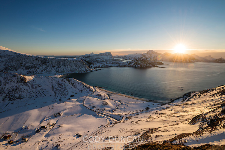 Winter sunset over Haukland beach, Vestvågøy, Lofoten Islands, Norway