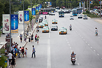 A view of street traffic and apartment buildings in Xian, Shaanxi, China.