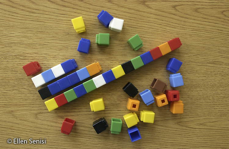 Schenectady, NY.Unix cubes on school desk..Unix cubes (which come in different colors and snap together) are used in a variety of ways as a hands-on, kinesthetic way to reinforce basic concepts in elementary level math lessons..©Ellen B. Senisi