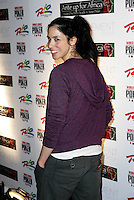 SARAH SILVERMAN.The Ante Up for Africa Celebrity Poker Tournament at the Rio Resort Hotel and Casino, Las Vegas, Nevada, USA..July 2nd, 2009.half length grey gray tracksuit bottoms looking over shoulder purple .CAP/ADM/MJT.© MJT/AdMedia/Capital Pictures