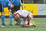 WASSENAAR - HOCKEY -  Blessure voor Billy Bakker tijdens de hoofdklasse competitiewedstrijd tussen de mannen van HGC en Amsterdam (3-3). COPYRIGHT KOEN SUYK