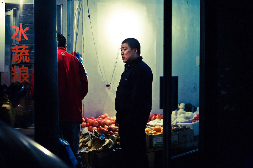 A grocekeeper in a hutong (traditionnal quarter) of Beijing. Food scandals are recurent in China, for industrial or fresh products, due to an unrestricted and massive use of chemical additives. In May 2011 watermelons have exploded in the south of China (Jiangsu province) after they had been treated with forcholorfenuron, a growth accelerator...