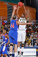 12 November 2010:  FIU's Brandon Moore (22) shoots a jump shot over Florida Memorial's Bryan Portillo (44) in the second half as the FIU Golden Panthers defeated the Florida Memorial Lions, 89-73, at the U.S. Century Bank Arena in Miami, Florida.
