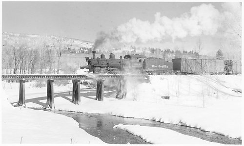 Leased D&amp;RGW #464 with flat cars rigged for carrying automobiles crossing RGS Bridge 146-A.<br /> RGS  Hesperus, CO  Taken by Richardson, Robert W. - 12/17/1951