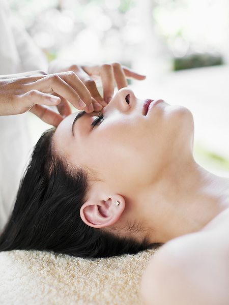 A woman receives a Purifying Facial, a 50-minute deep cleansing facial that uses flower essences, active clays, and plant extracts of lavender, lemon and tea tree, combined with a facial lymphatic drainage massage.  Six Senses Hideaway Yao Noi, Koh Yao Noi, Thailand.