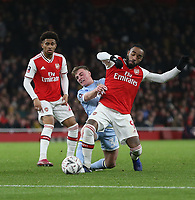 Arsenal's Alexandre Lacazette and Leeds United's Robbie Gotts<br /> <br /> Photographer Rob Newell/CameraSport<br /> <br /> Emirates FA Cup Third Round - Arsenal v Leeds United - Monday 6th January 2020 - The Emirates Stadium - London<br />  <br /> World Copyright © 2020 CameraSport. All rights reserved. 43 Linden Ave. Countesthorpe. Leicester. England. LE8 5PG - Tel: +44 (0) 116 277 4147 - admin@camerasport.com - www.camerasport.com