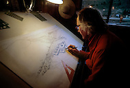 Wasco, Oregon, January 1984: A disciple of Bhagwan Rajneesh working on an architectural plan in a office in Rajneeshpuram.   Rajneeshpuram, was an intentional community in Wasco County, Oregon, briefly incorporated as a city in the 1980s, which was populated with followers of the spiritual teacher Osho, then known as Bhagwan Shree Rajneesh. The community was developed by turning a ranch from an empty rural property into a city complete with typical urban infrastructure, with population of about 7000 followers.