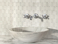 Wicker, a hand-cut tumbled mosaic, shown in Dolomite, is part of the Tissé® collection for New Ravenna.