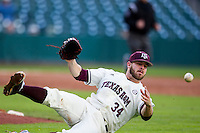 Texas A&M Aggies pitcher A.J. Minter (34) falls down as he throws the ball to first base during Houston College Classic against the Nebraska Cornhuskers on March 6, 2015 at Minute Maid Park in Houston, Texas. Texas A&M defeated Nebraska 2-1. (Andrew Woolley/Four Seam Images)