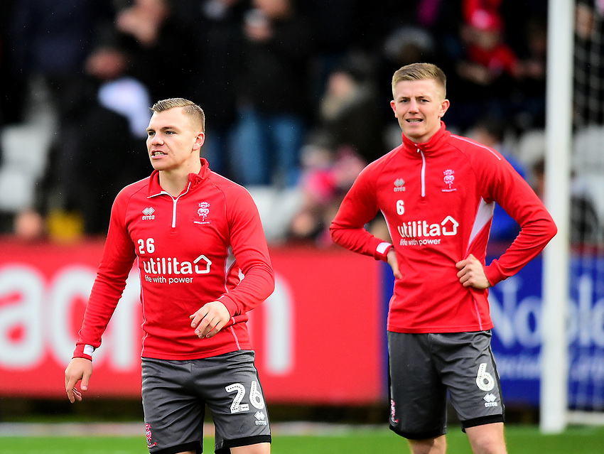 Lincoln City's Harry Anderson, left, and Scott Wharton during the pre-match warm-up<br /> <br /> Photographer Andrew Vaughan/CameraSport<br /> <br /> The EFL Sky Bet League Two - Stevenage v Lincoln City - Saturday 8th December 2018 - The Lamex Stadium - Stevenage<br /> <br /> World Copyright © 2018 CameraSport. All rights reserved. 43 Linden Ave. Countesthorpe. Leicester. England. LE8 5PG - Tel: +44 (0) 116 277 4147 - admin@camerasport.com - www.camerasport.com