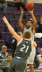 SIOUX FALLS, SD - DECEMBER 8:  Jared Mayes #22 from the University of Sioux Falls spots up for a jumper over Turner Moen #21 from Southwest Minnesota State Tuesday night at the Stewart Center. (Photo by Dave Eggen/Inertia)