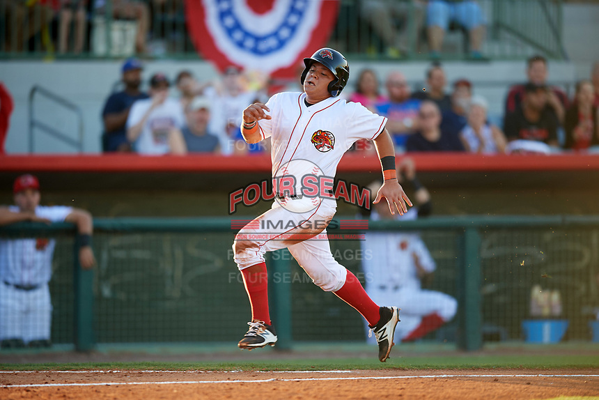 Florida Fire Frogs catcher Jonathan Morales (4) scores the first run in the bottom of the second inning on a Carlos Castro (not shown) single during the teams inaugural game against the Daytona Tortugas on April 6, 2017 at Osceola County Stadium in Kissimmee, Florida.  Daytona defeated Florida 3-1.  (Mike Janes/Four Seam Images)