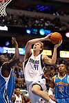 Dallas' Dirk Nowitzki goes for a layup against New Orleans' Emeka Okafor, left, and David West in the first half during an NBA basketball game at American Airlines Center in Dallas on February 28, 2010.   (Photo by Khampha Bouaphanh)