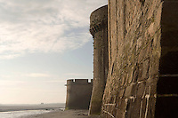 Remarkable example of 15th century military architecture, the Ramparts with its parapet resting on corbelled machicolations and crowning both towers and walls, constructed mostly during the Hundred Years War, Le Mont Saint Michel, 13th century, thanks to a donation by the king of France, Philip Augustus, Manche, Basse Normandie, France. Picture by Manuel Cohen