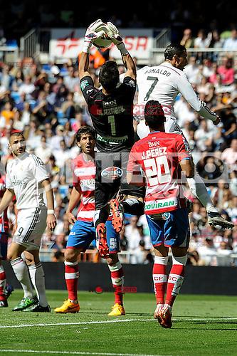 Real Madrid´s Cristiano Ronaldo and Granada´s goalkeeper Oier Olazabal during 2014-15 La Liga match between Real Madrid and Granada at Santiago Bernabeu stadium in Madrid, Spain. April 05, 2015. (ALTERPHOTOS/Luis Fernandez) /NORTEphoto.com