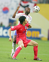 Jae Jin Cho (19) of Korea holds off William Gallas (5) of France. The Korea Republic and France played to a 1-1 tie in their FIFA World Cup Group G match at the Zentralstadion, Leipzig, Germany, June 18, 2006.