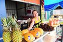Silvia Enriques of El Salvador serves liquados frescas at Fruteria Dani at the Westbank Nawlins Flea Market.