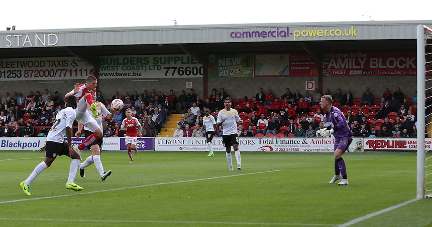 Fleetwood Town's Jamie Proctor scores his sides third goal despite the attentions of Colchester United's Kane Vincent-Young and Tom Eastman<br /> <br /> Photographer Stephen White/CameraSport<br /> <br /> Football - The Football League Sky Bet League One - Fleetwood Town v Colchester United - Saturday 22nd August 2015 - Highbury Stadium - Fleetwood<br /> <br /> &copy; CameraSport - 43 Linden Ave. Countesthorpe. Leicester. England. LE8 5PG - Tel: +44 (0) 116 277 4147 - admin@camerasport.com - www.camerasport.com
