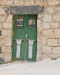 Umm Qais, northwestern Jordan:  A crooked door blocks off one of the buildings that is being reconstructed at the biblical town of Gadara.  © Rick Collier