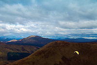 A paraglider descending from Beinn Eich, the Luss Hills, Loch Lomond and the Trossachs National Park
