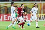 Guangzhou Forward Gao Lin (C) fights for the ball with Kashima Defender Yamamoto Shuto (L) during the AFC Champions League 2017 Round of 16 match between Guangzhou Evergrande FC (CHN) vs Kashima Antlers (JPN) at the Tianhe Stadium on 23 May 2017 in Guangzhou, China. (Photo by Power Sport Images/Getty Images)