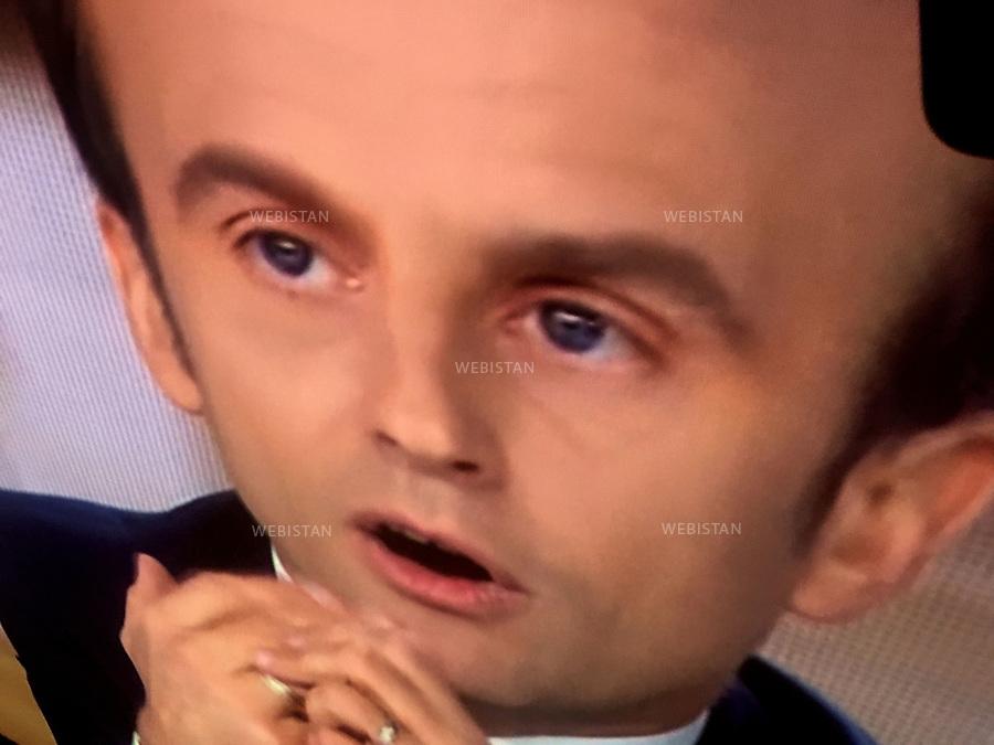 Gueules de campagne. Photocature par Reza. <br />Emmanuel Macron. Mouvement fran&ccedil;ais: En marche!<br />France. Paris. 4 mai 2017. Second d&eacute;bat pour les &eacute;lections pr&eacute;sidentielles fran&ccedil;aises  avec les 2 candidats sur les cha&icirc;nes de t&eacute;l&eacute;visions TF1 et France 2.<br /><br />&quot;President candidates' portraits gallery&quot;, photographic caricature by Reza.<br />Emmanuel Macron. Head of the french political movement En Marche!<br />France. Paris. 4 May 2017. Second debate for the french presidential elections with the 2 candidates on the TF1 and France 2 television channels.