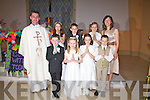The First Communion Class from Foilmore NS who made their communion on Sunday last pictured front l-r; Seamus Sugrue, Ellie Kavanagh, Rachel O'Grady, Fiachra Collins, back l-r; Fr Nial Howard, Amelia O'Sullivan, Kevin Murphy, Niamh Clifford & Nora Golden(Principal).