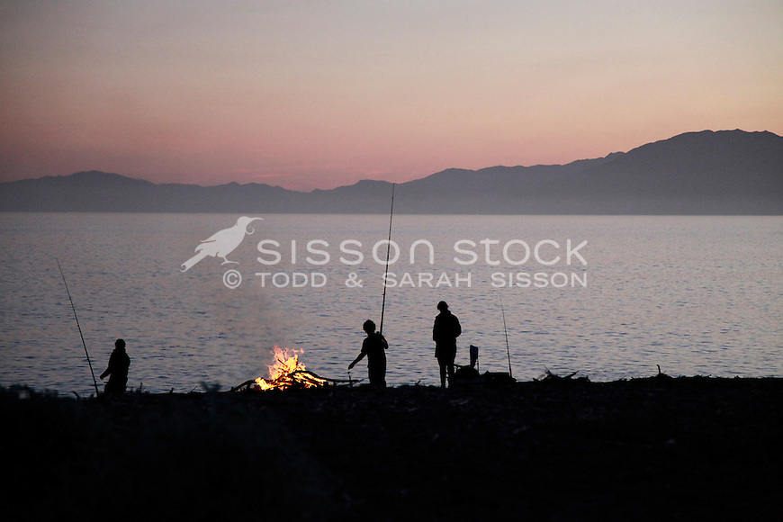 People fishing with camp fire at South Bay, twilight, Kaikoura