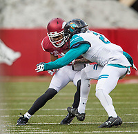 Hawgs Illustrated/BEN GOFF <br /> Deon Stewart, Arkansas wide receiver, tries to evade Dontay Hears (2), Coastal Carolina cornerback, after a catch in the second quarter Saturday, Nov. 4, 2017, at Reynolds Razorback Stadium in Fayetteville.