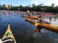 Great River Rumble paddlers start another day on the Mississippi River.