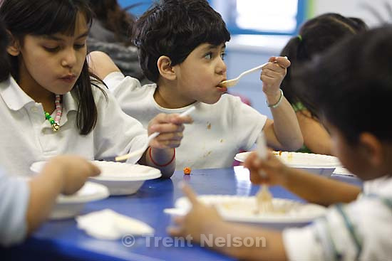 Salt Lake City - Kids Cafe, a free dinner is served at the Capitol West Boys and Girls Club Wednesday, March 5, 2008. The number of children living in poverty in Salt Lake City has gone up from about 19 percent in 1999 to more than 28 percent in the latest census data.