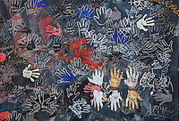 Section of the Berlin Wall depicting a detail from Touch The Wall by Christine Kuhn, damaged by graffiti, part of the East Side Gallery, a 1.3km long section of the Wall on Muhlenstrasse painted in 1990 on its Eastern side by 105 artists from around the world, Berlin, Germany. Picture by Manuel Cohen