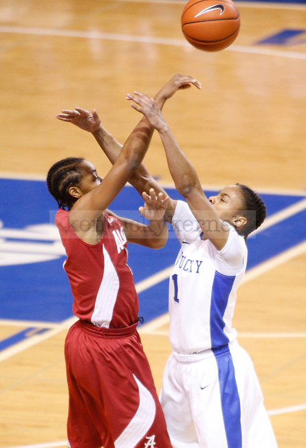 UK guard A'dia Mathies attempts to block a pass made by Alabama guard Celiscia Farmer during the first half of the UK Women's basketball game against Alabama on 1/29/12 at Memorial Coliseum in Lexington, Ky. Photo by Quianna Lige | Staff