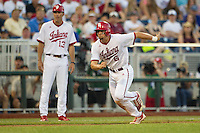Indiana Hoosiers head coach Tracy Smith (13) watches first baseman Sam Travis (6) sprints home against the Mississippi State Bulldogs during Game 6 of the 2013 Men's College World Series on June 17, 2013 at TD Ameritrade Park in Omaha, Nebraska. The Bulldogs defeated Hoosiers 5-4. (Andrew Woolley/Four Seam Images)