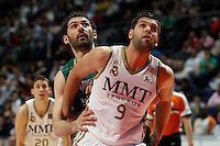 01.04.2012 SPAIN - ACB match played between Real Madrid vs Unicaja  at Palacio de los deportes stadium. The picture show Jorge Garbajosa (Unicaja) and Felipe Reyes Cabanas (Spanish center of Real Madrid)
