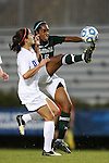 10 November 2012: Loyola Maryland's Kelsey Rene (5) clears the ball away from Duke's Laura Weinberg (left). The Duke University Blue Devils played the Loyola University Maryland Greyhounds at Koskinen Stadium in Durham, North Carolina in a 2012 NCAA Division I Women's Soccer Tournament First Round game. Duke won the game 6-0.
