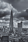 The Shard building in London England under cloudy skies