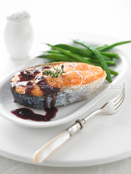 Salmon cooked with skin on, with green beans and red wine sauce.
