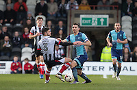 Matt Bloomfield of Wycombe Wanderers battles Danny Andrew of Grimsby Town during the Sky Bet League 2 match between Grimsby Town and Wycombe Wanderers at Blundell Park, Cleethorpes, England on 4 March 2017. Photo by Andy Rowland / PRiME Media Images.