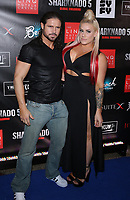 06 August 2017 - Las Vegas, NV - John Hennigan, Taya Valkyrie.  Sharknado 5 Global Swarming red carpet premiere at Linq Hotel and Casino. Photo Credit: MJT/AdMedia