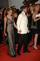 ANGELINA JOLIE &amp; BRAD PITT<br /> Premiere of &quot;The Assassination of Jesse James by the Coward Robert Ford&quot; at the 64th Venice Film Festival (La Biennale di Venezia), Venice, Italy.<br /> September 2nd, 2007<br /> full length long black lace layered dress maxi clutch bag pearl necklace couple cream white tuxedo jacket shirt suit black trousers bow tie  holding hands profile tattoos<br /> Ref: CAP/PL<br /> &copy;Phil Loftus/Capital Pictures /MediaPunch ***NORTH AND SOUTH AMERICAS ONLY***
