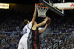 San Diego State forward Yanni Wetzell (5) is fouled as he shoots by Nevada forward K.J. Hymes (42) during the second half of a basketball game played at Lawlor Events Center in Reno, Nev., Saturday, Feb. 29, 2020. (AP Photo/Tom R. Smedes)