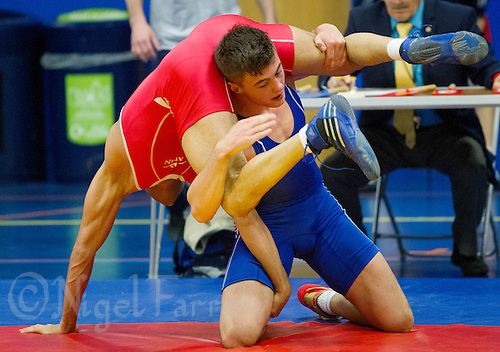 11 MAY 2014 - SHEFFIELD, GBR - Charlie Bowling (left) tries to turn his opponent during their men's 65kg category freestyle match at the British 2014 Senior Wrestling Championships in EIS in Sheffield, Great Britain (PHOTO COPYRIGHT © 2014 NIGEL FARROW, ALL RIGHTS RESERVED)