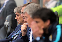 Manuel Pellegrini, Manager of Manchester City (L) during the Swansea City FC v Manchester City Premier League game at the Liberty Stadium, Swansea, Wales, UK, Sunday 15 May 2016