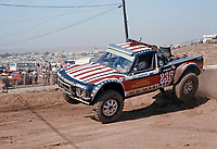 Mickey Thompson (235) races his Chevy pickup named Luv with 454 cu. inch Chevy V-8 stuffed in the bed, AC-Delco Off-Road Championships, Riverside Raceway, Sept 5, 1975. Photo by John G. Zimmerman.