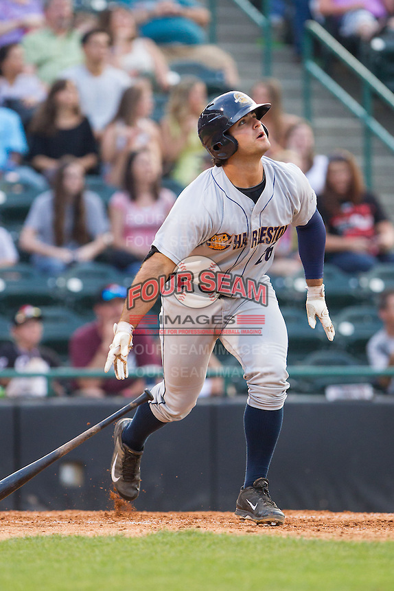 Mike Ford (26) of the Charleston RiverDogs watches the flight of his third home run on the day against the Hickory Crawdads at L.P. Frans Stadium on May 25, 2014 in Hickory, North Carolina.  The RiverDogs defeated the Crawdads 17-10.  (Brian Westerholt/Four Seam Images)