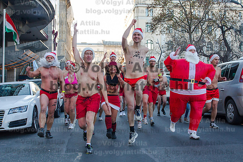 "People participate a half naked ""Santa run"" organised the 5th time to support a charity in Budapest, Hungary on December 09, 2012. ATTILA VOLGYI"